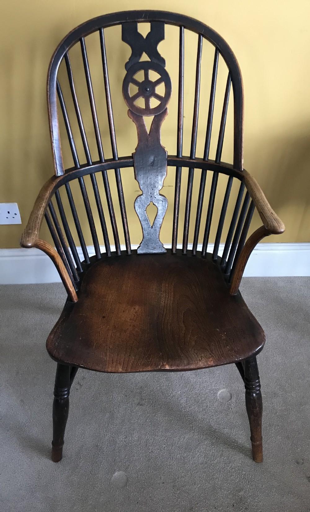 an 18thc country windsor wheelback armchair