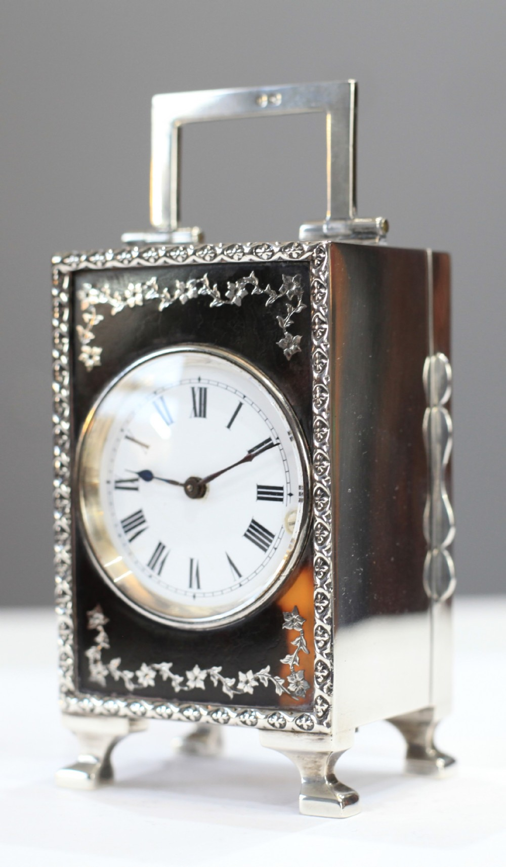 miniature sterling silver carriage clock with tortoise shell and inlay panel c1908