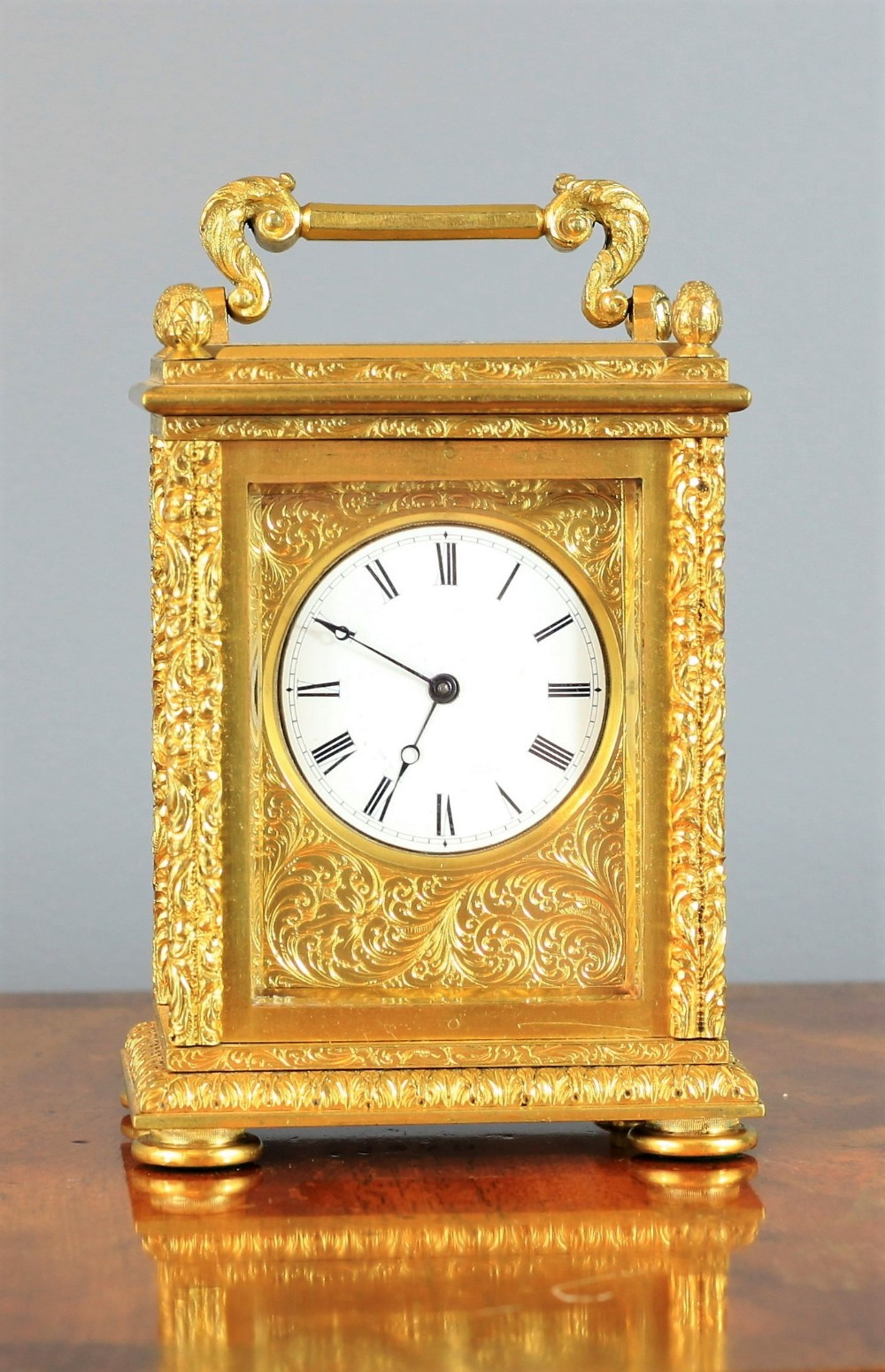 a stunning highly engraved gilt miniature english fusee carriage clock c1870
