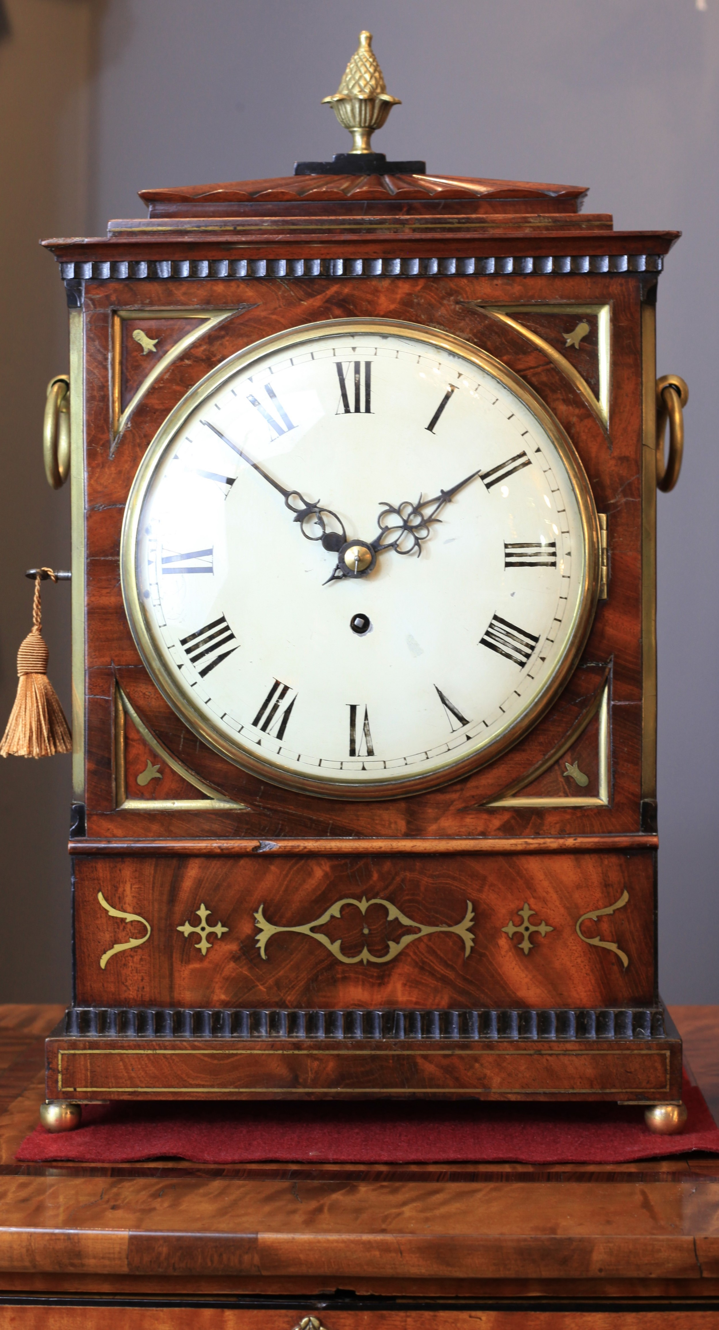 a regency period mahogany bracket clock with brass inlay and original painted dial