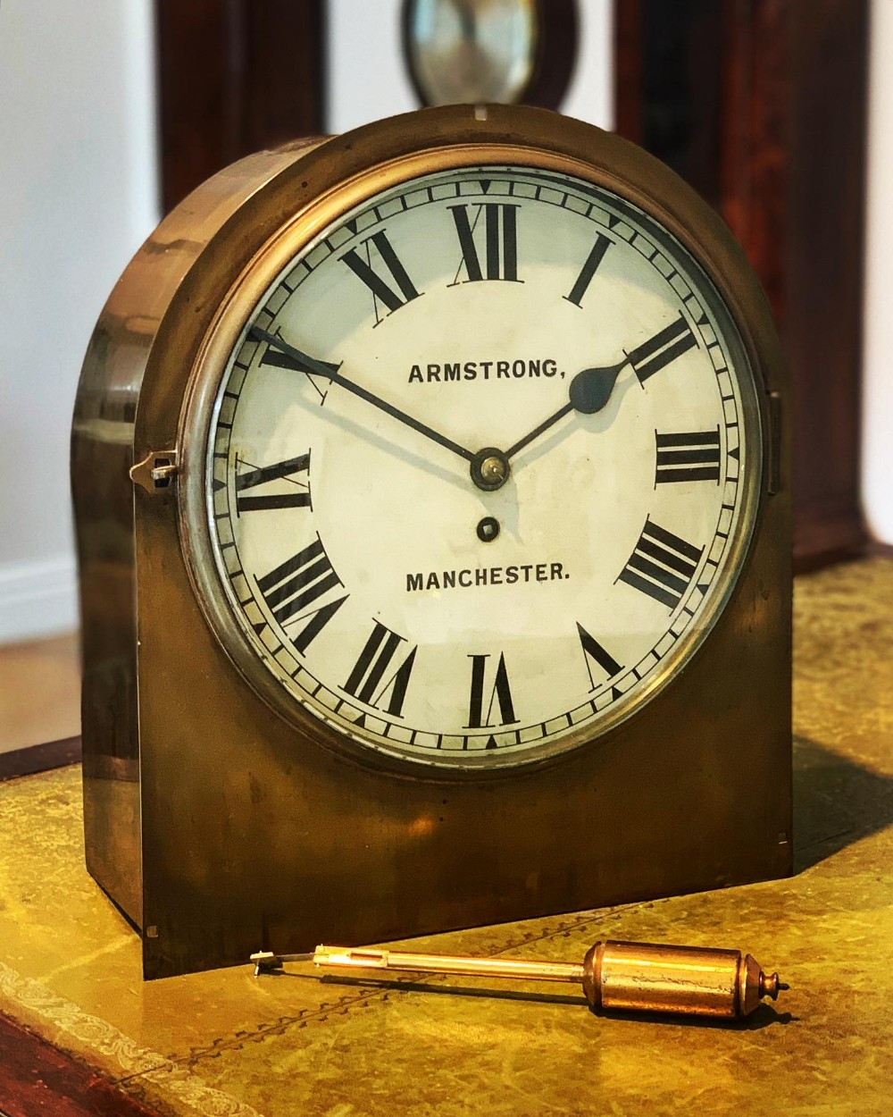 an unusual walltable clock by armstrong of manchester