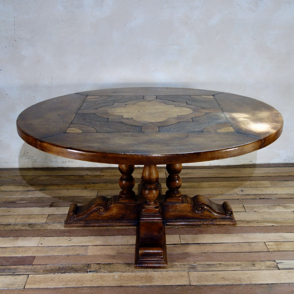 a large provincial 20th cent continental walnut center dining table round