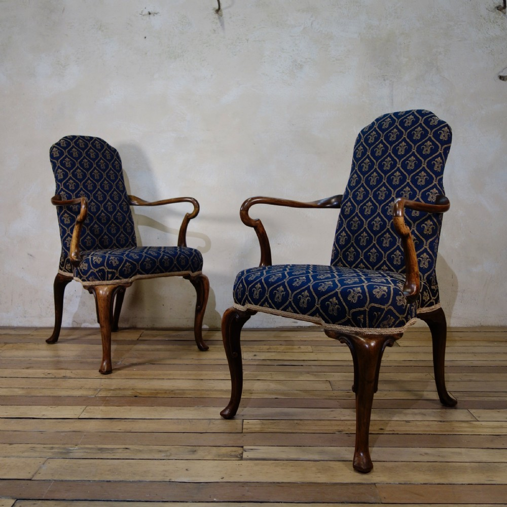 a pair of early 20th century queen anne upholstered open armchairs shepherd crook arms