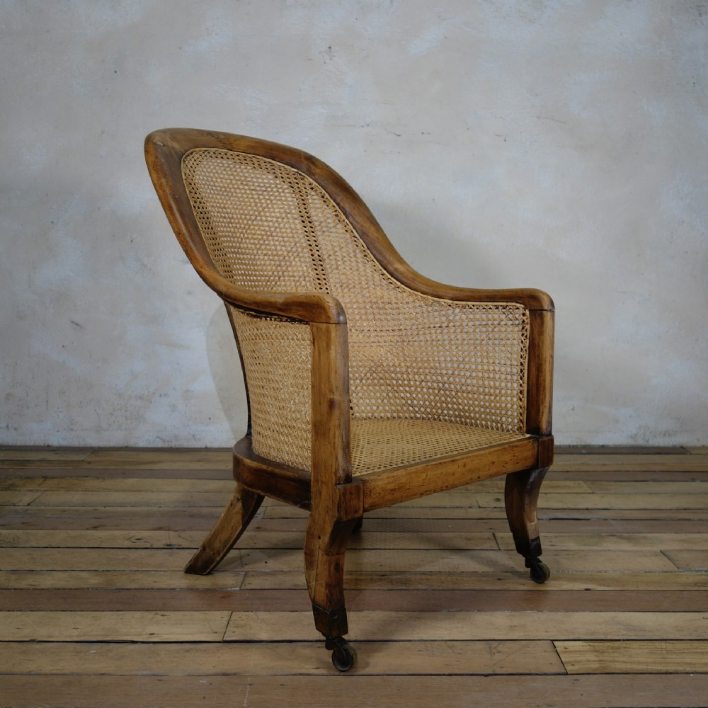 a regency 19th century caned bergere library tub chair gillows manner