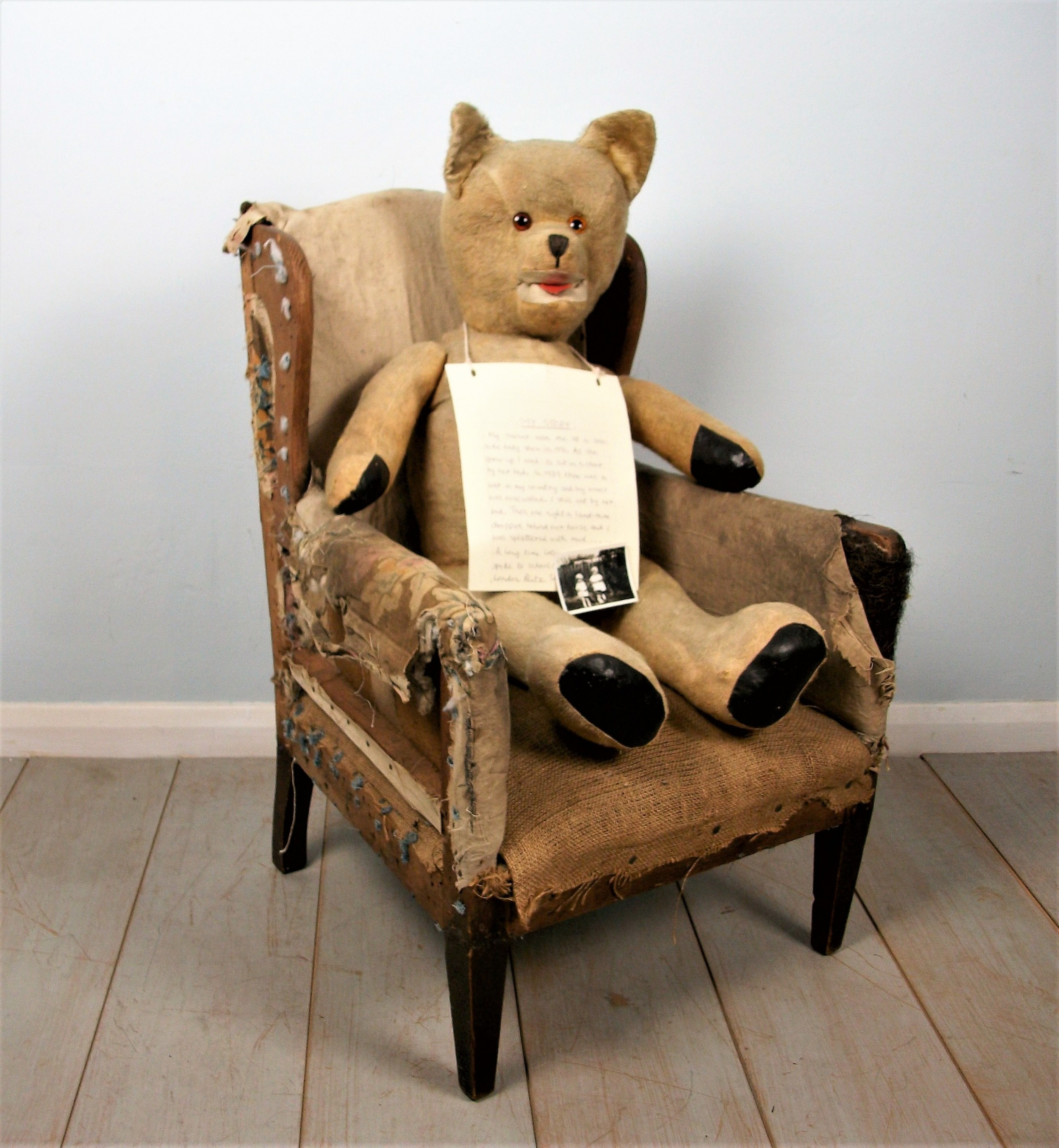 childs wing chair and bear