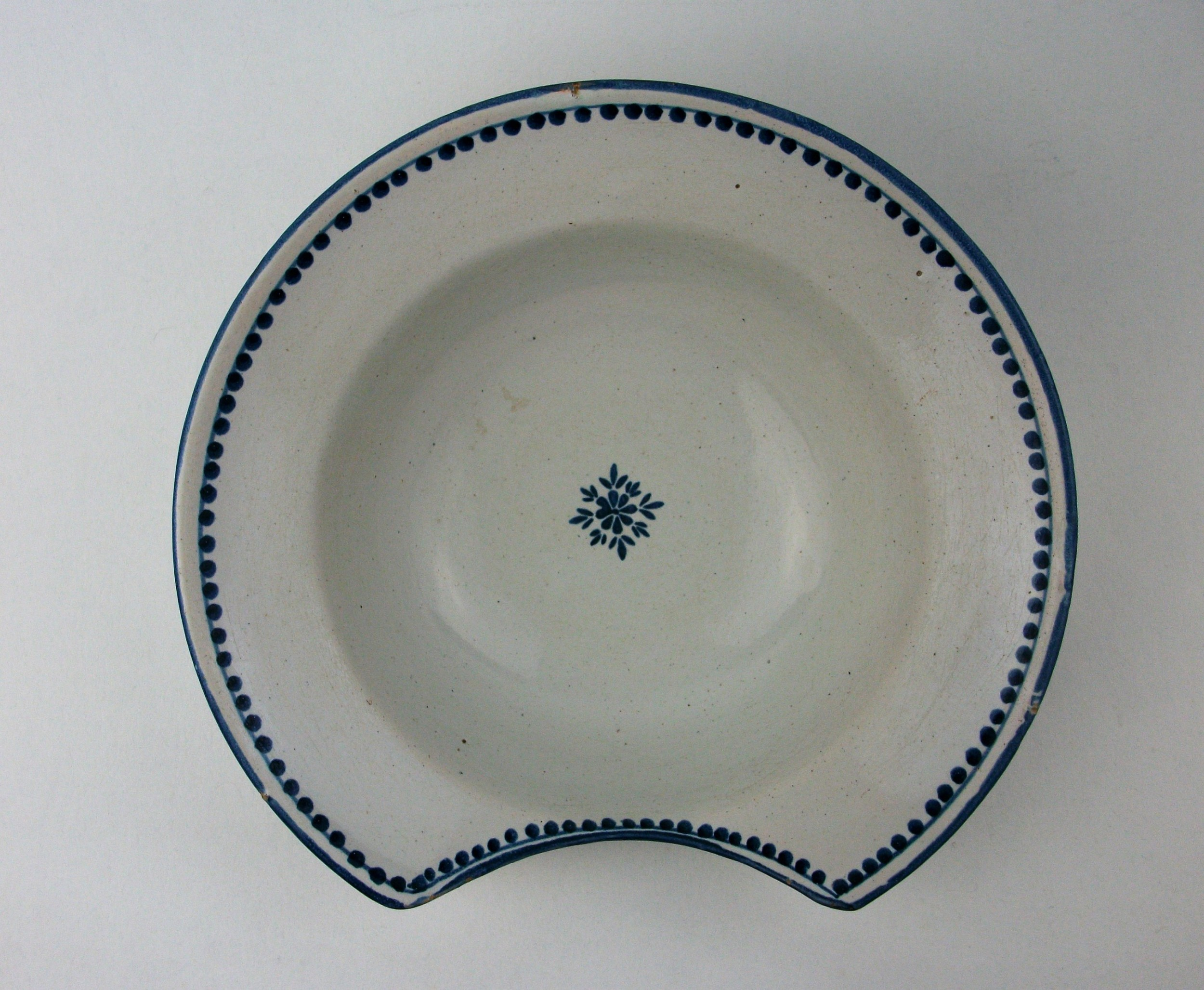 an 18th century delft blue and white barbers bowl