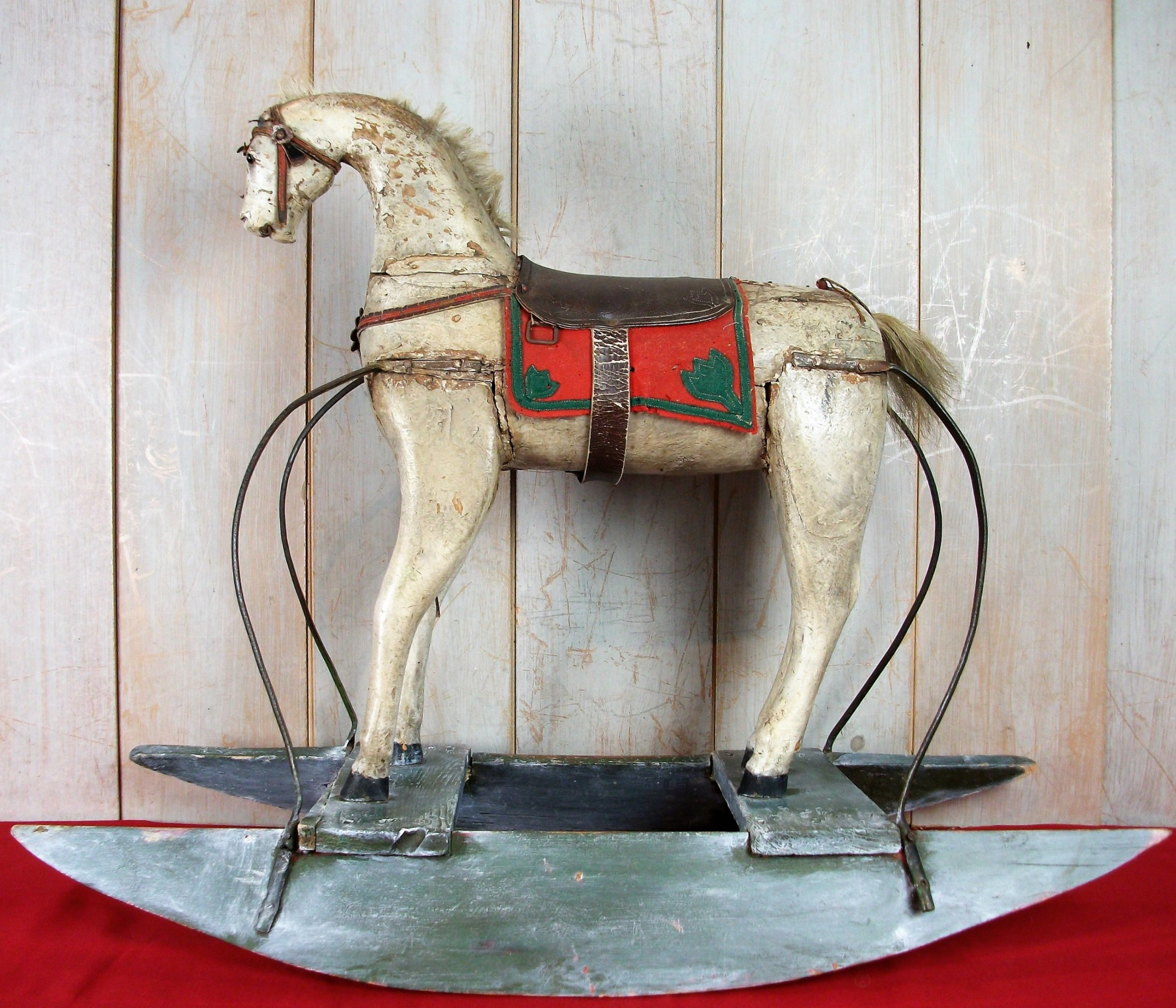 a spanish 19thc naive painted wooden folk art wood rocking horse