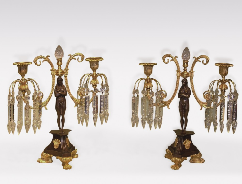 pair of early 19th century bronze ormolo and glass lustre candlesticks