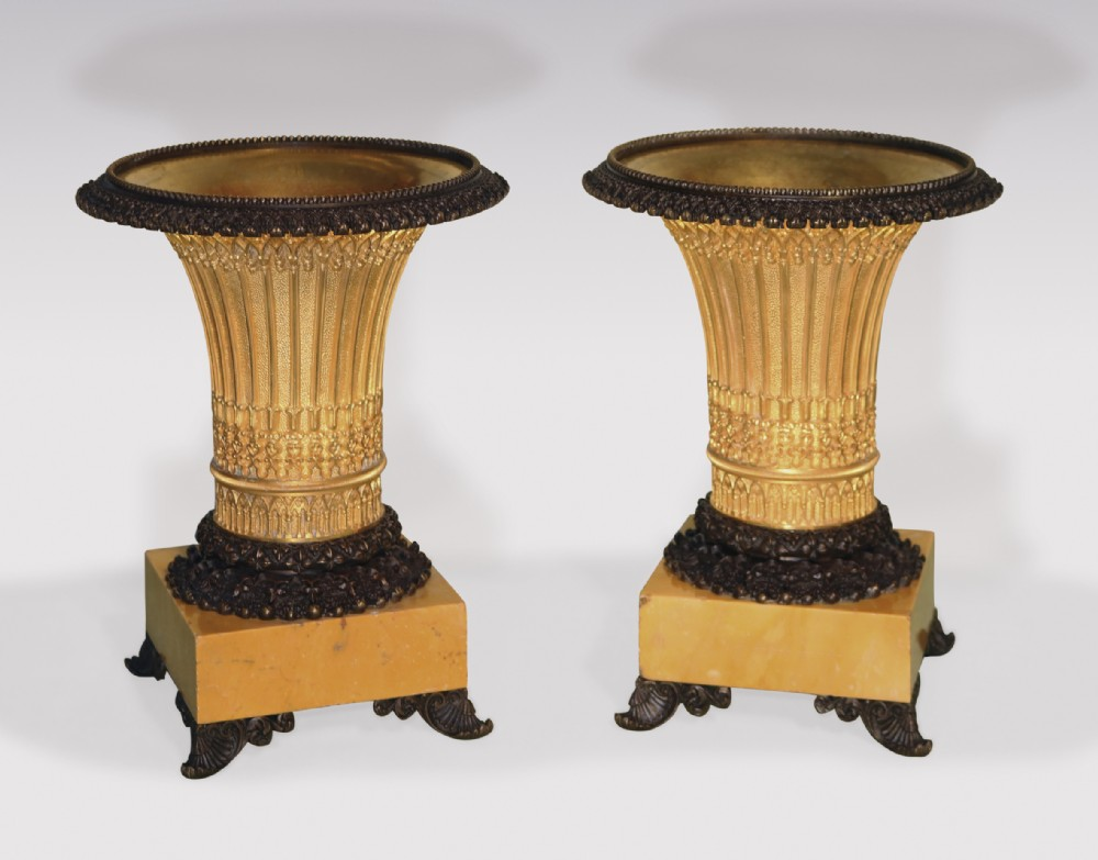 pair of early 19th century bronze and ormolu gothic style vaseshaped tazzas