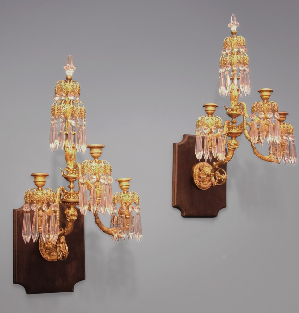 a pair of regency period gilt bronze and glass wall lights