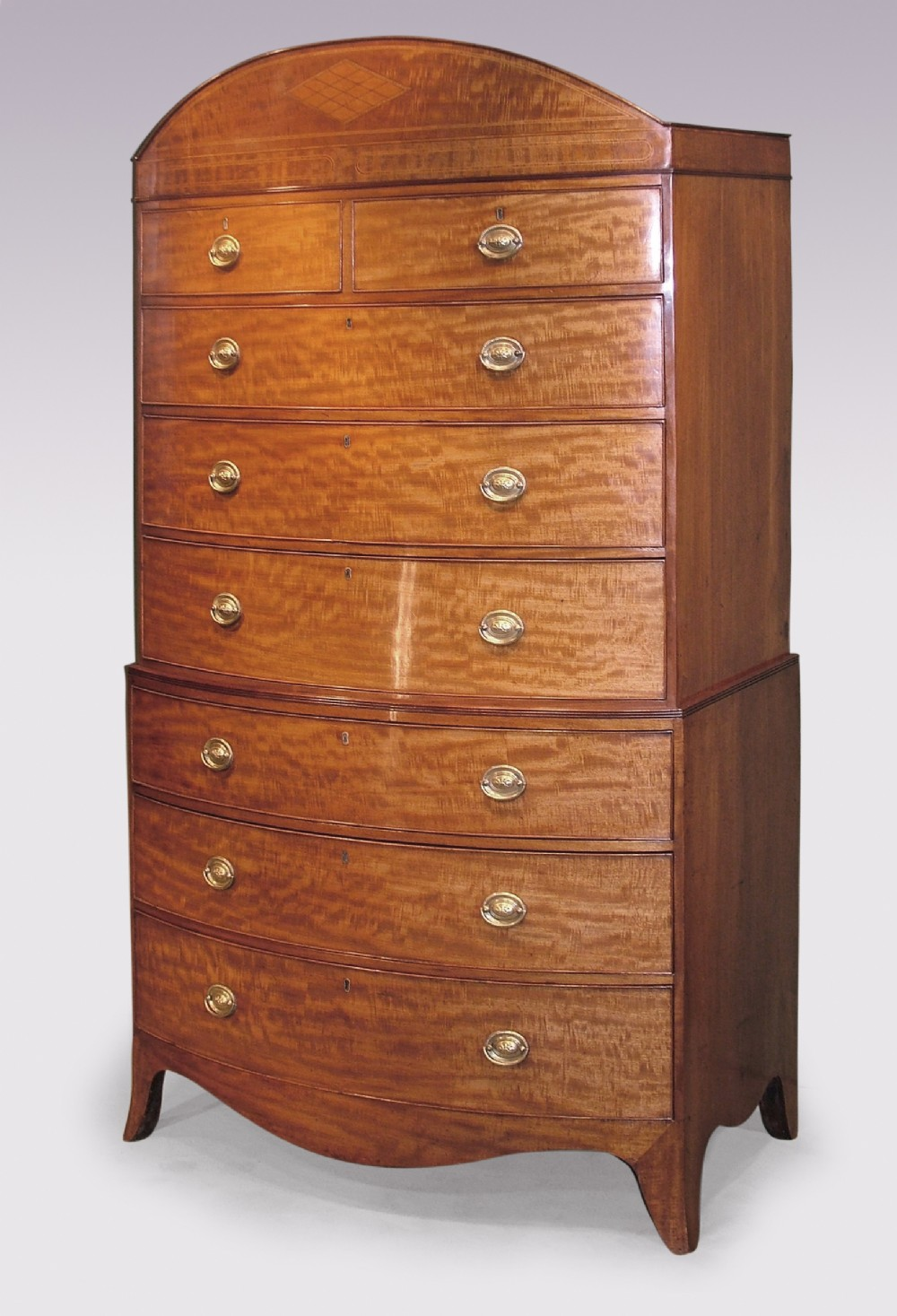 a george iii period golden mahogany bow fronted tallboy