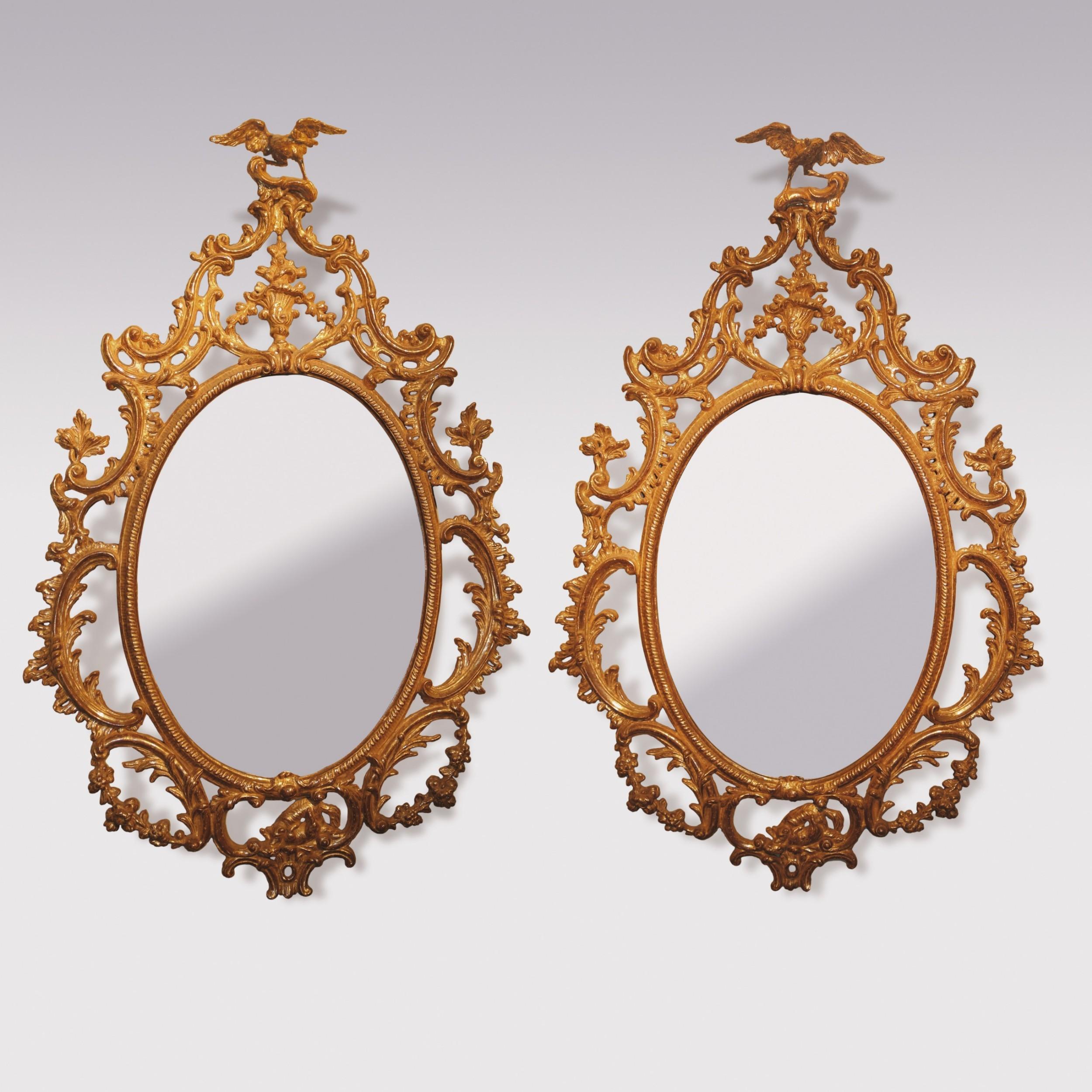 rare pair of george iii gilt wood oval mirrors