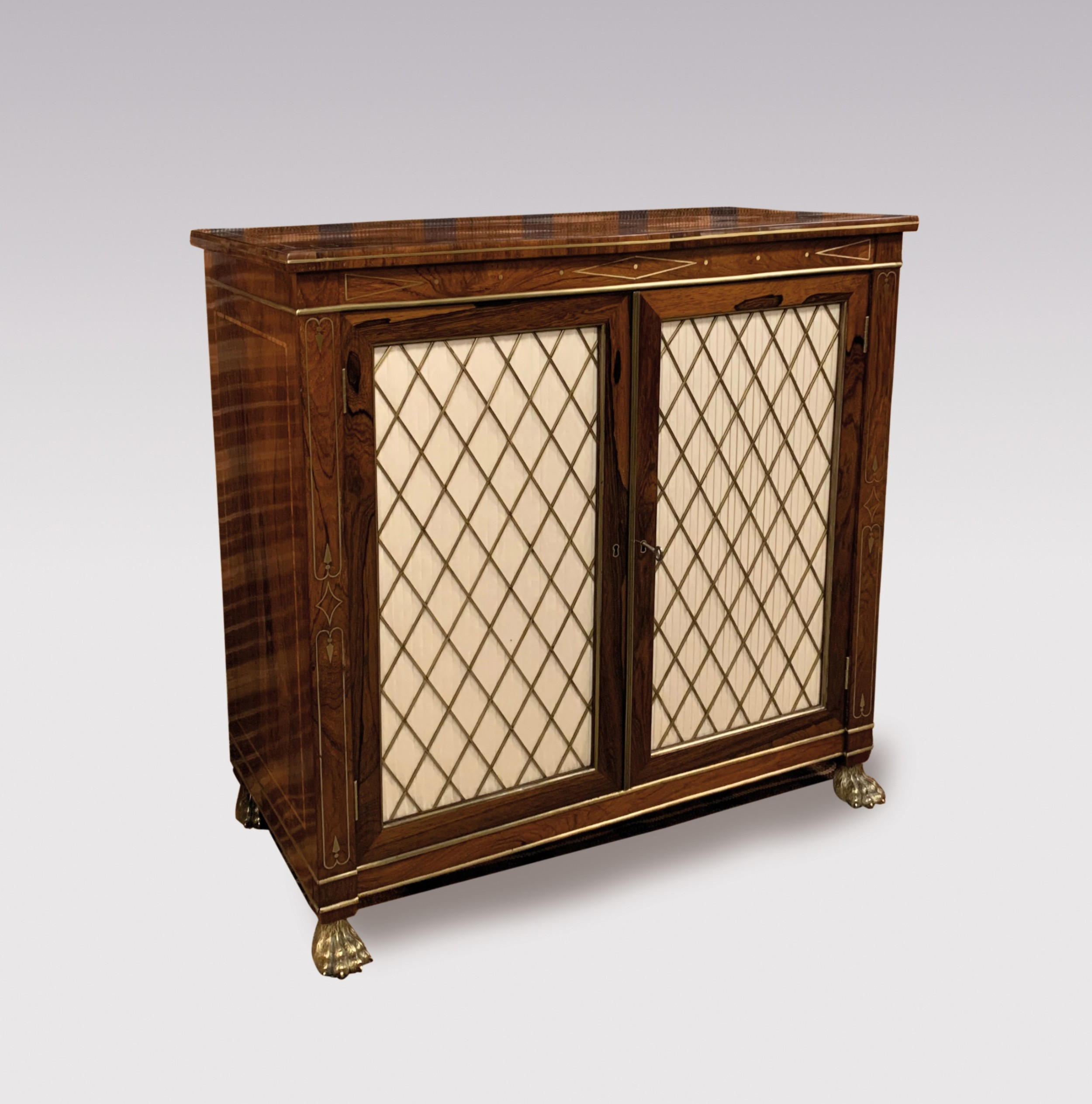 early 19th century regency period rosewood and brass inlaid two door cabinet