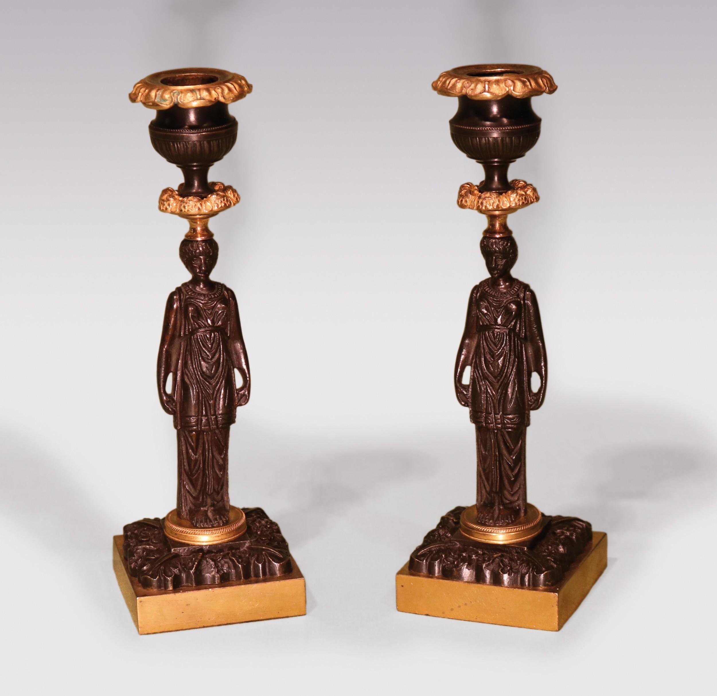 a pair of 19th century regency period bronze ormolu lady candlesticks