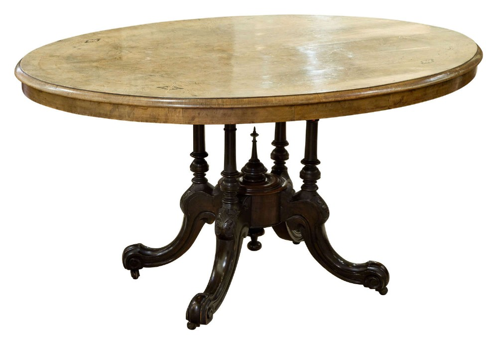 an oval inlaid walnut loo table on quadruple base