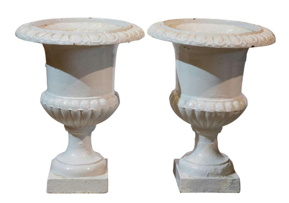 pair of 19th c cast iron vases