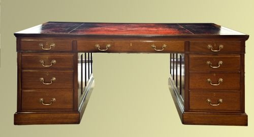 late edwardian mahogany nine drawer desk