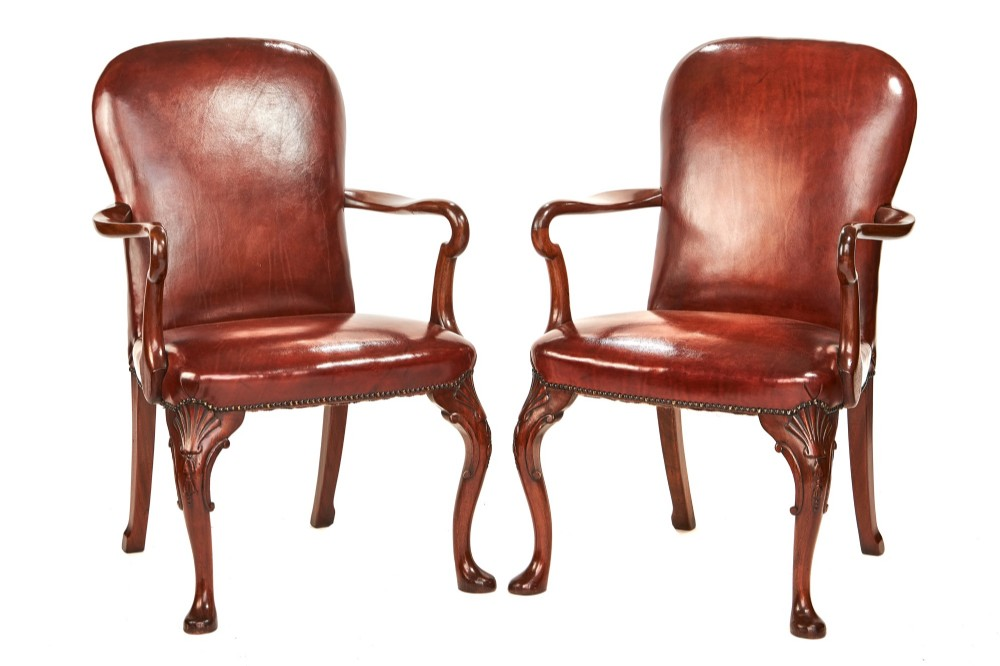 pair georgian revival leather open elbow chairs circa 1920s