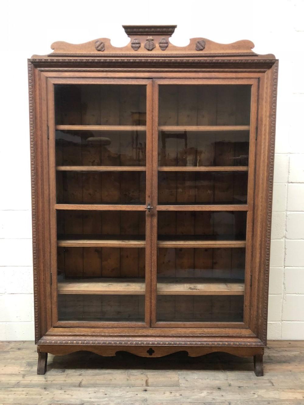 large antique carved oak glazed bookcase