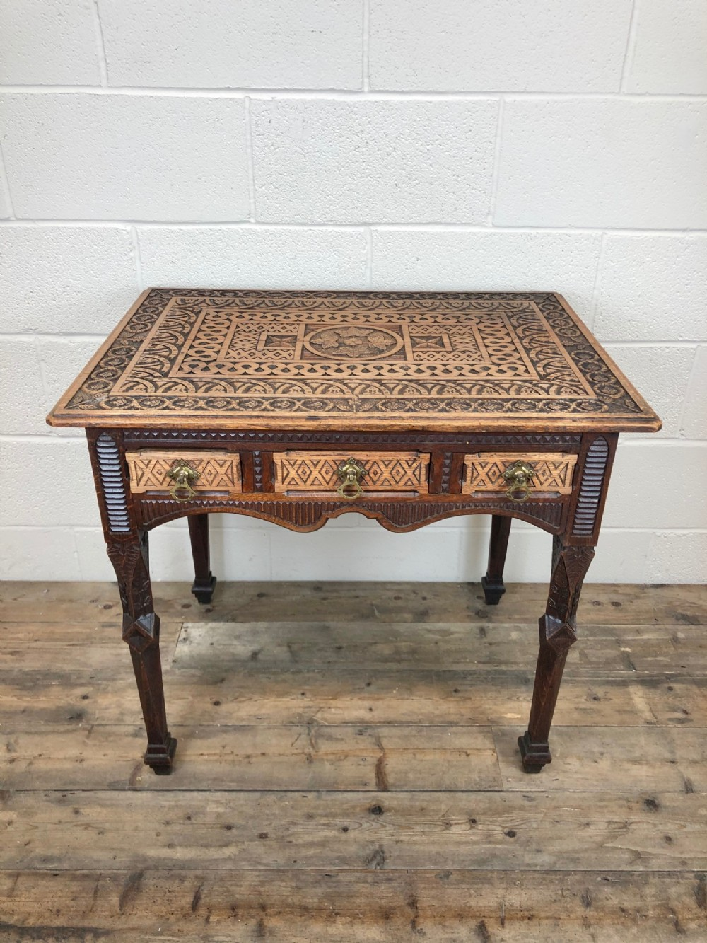 unusual heavily carved oak arts and crafts side table
