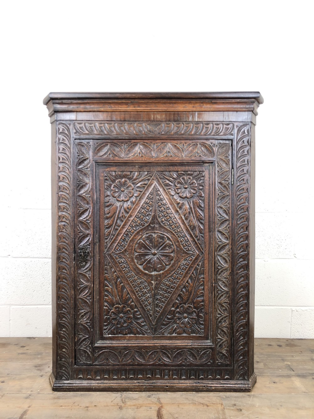18th century carved oak wall hanging corner cupboard