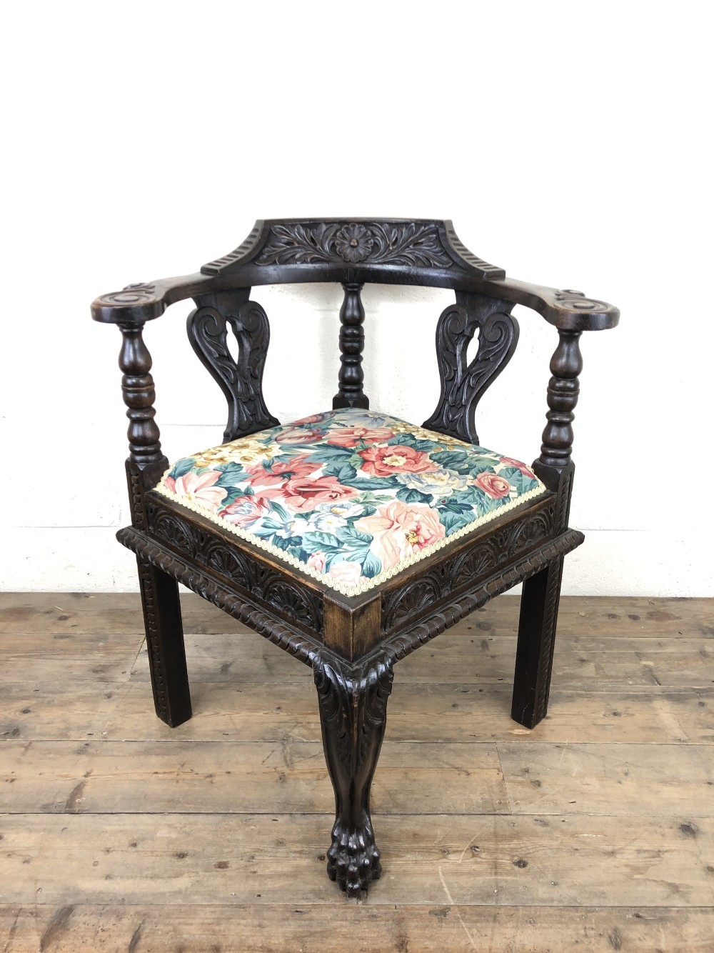 victorian carved oak corner chair with floral upholstery