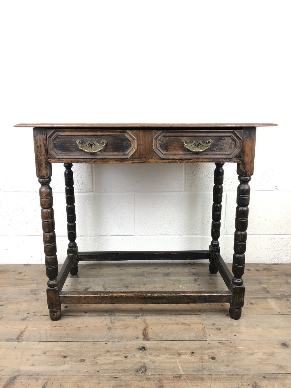 antique oak side table with geometric drawers