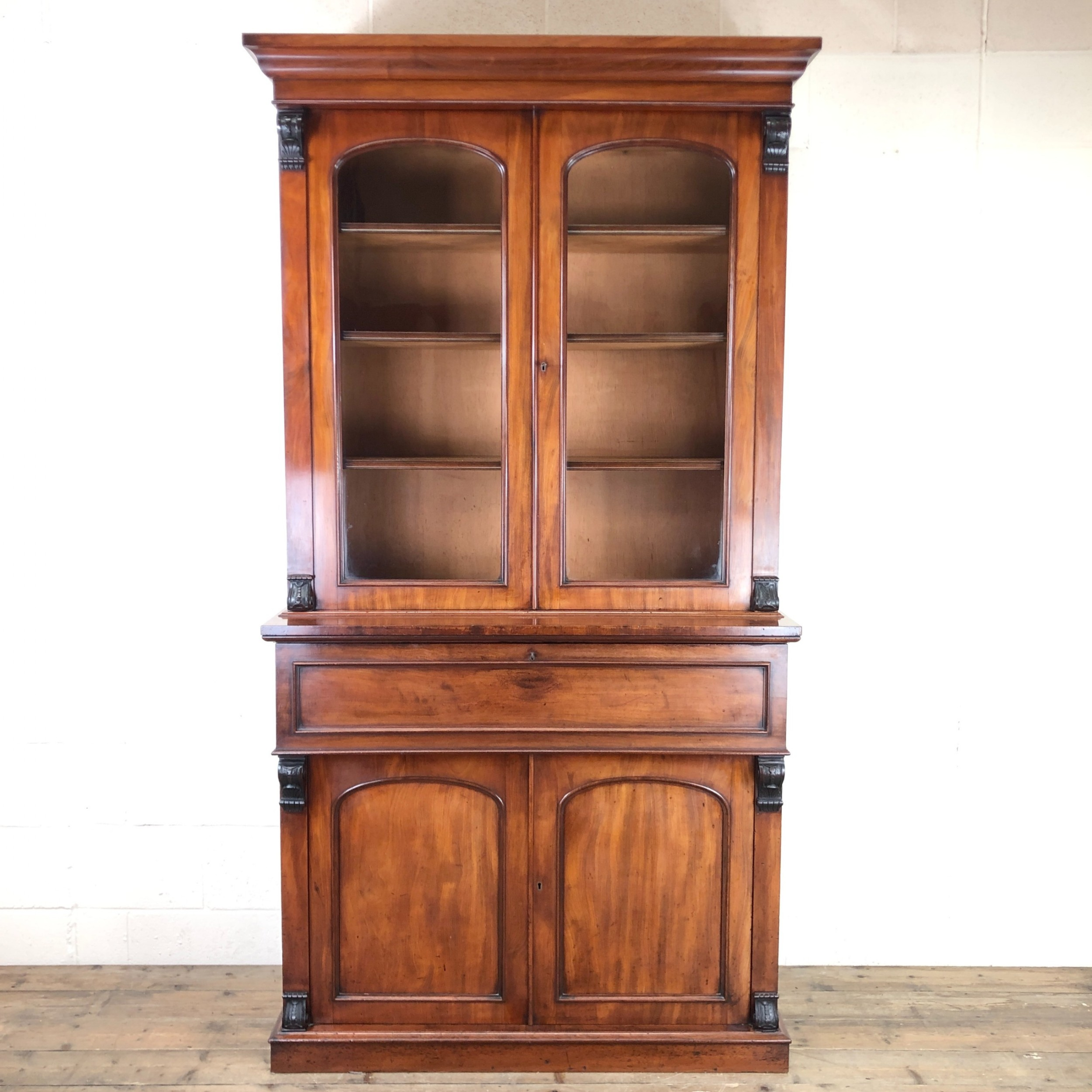 antique mahogany bookcase with inset writing surface