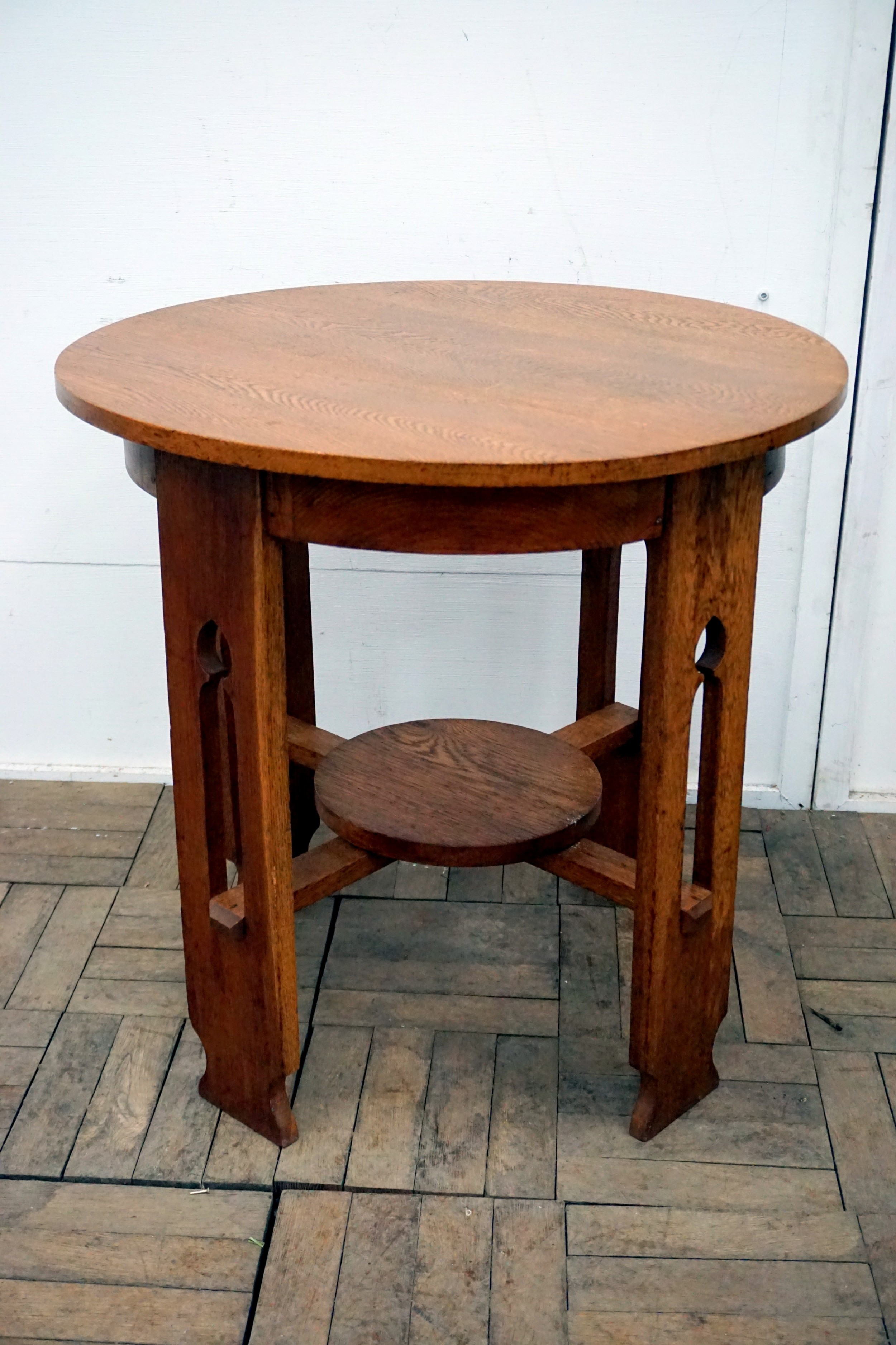 a good solid oak arts and crafts circular occasional table