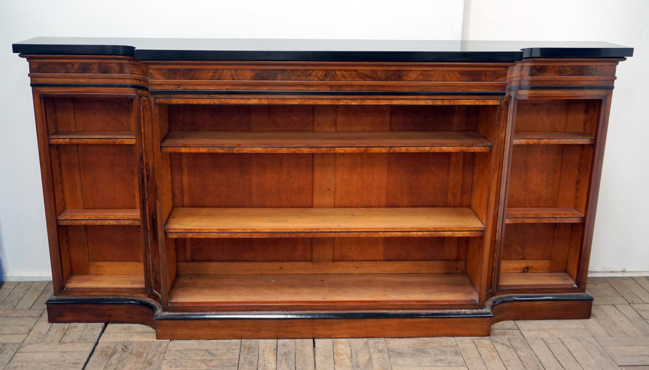 a magnificent narrow victorian walnut and ebonised open shelf bookcase