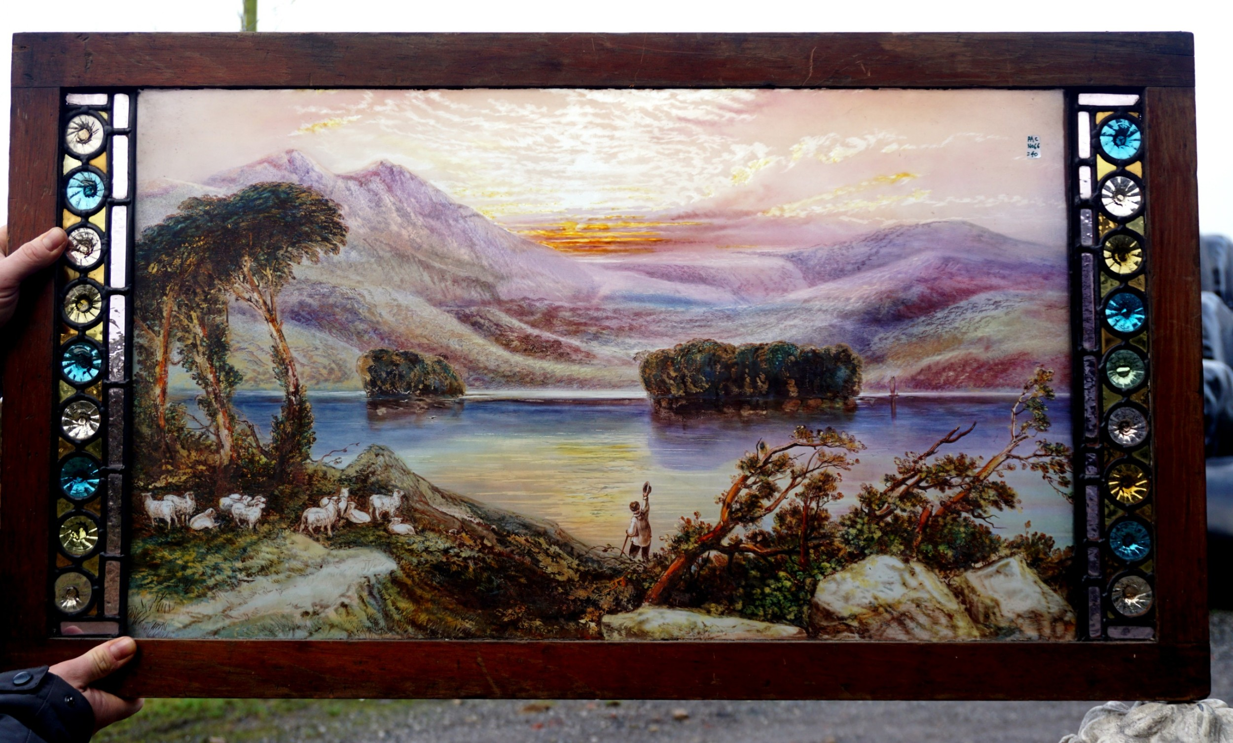a very well painted scottish scene stained glass window