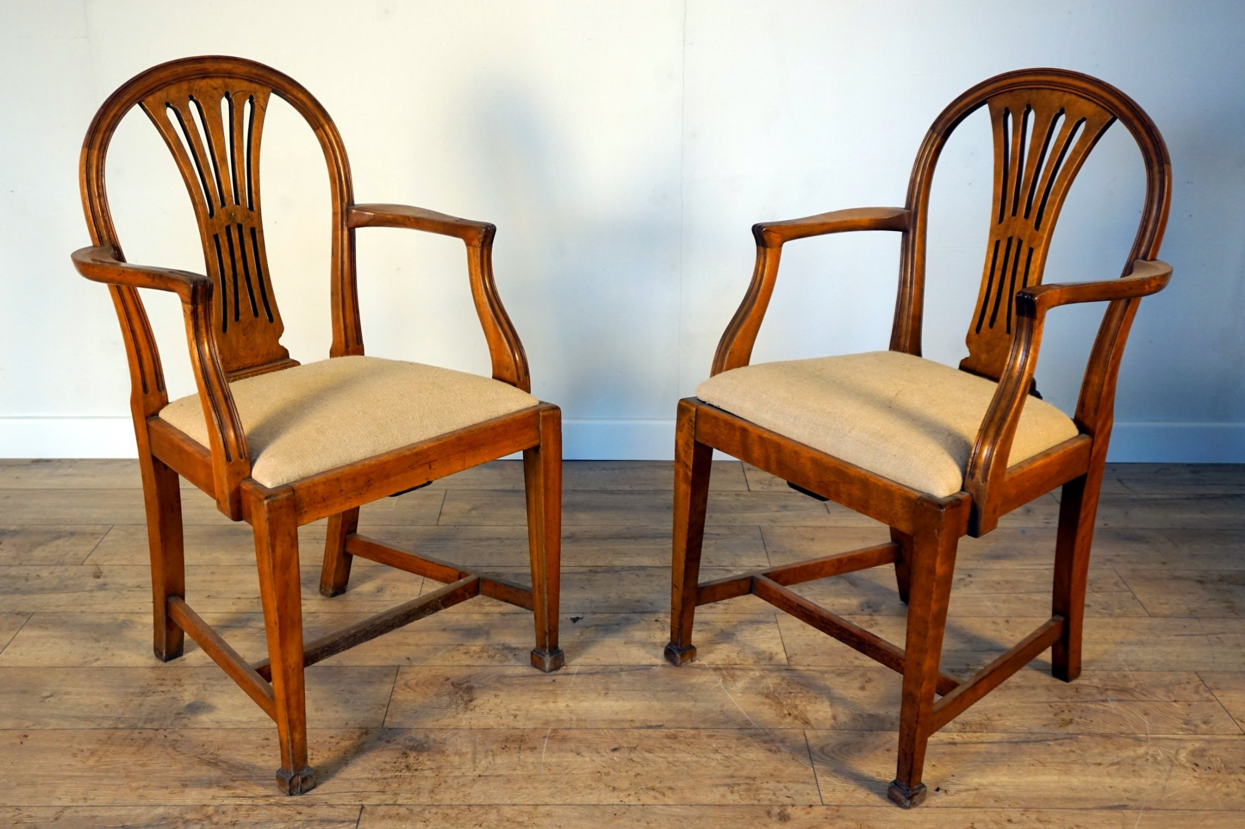 a pair of birch and elm armchairs