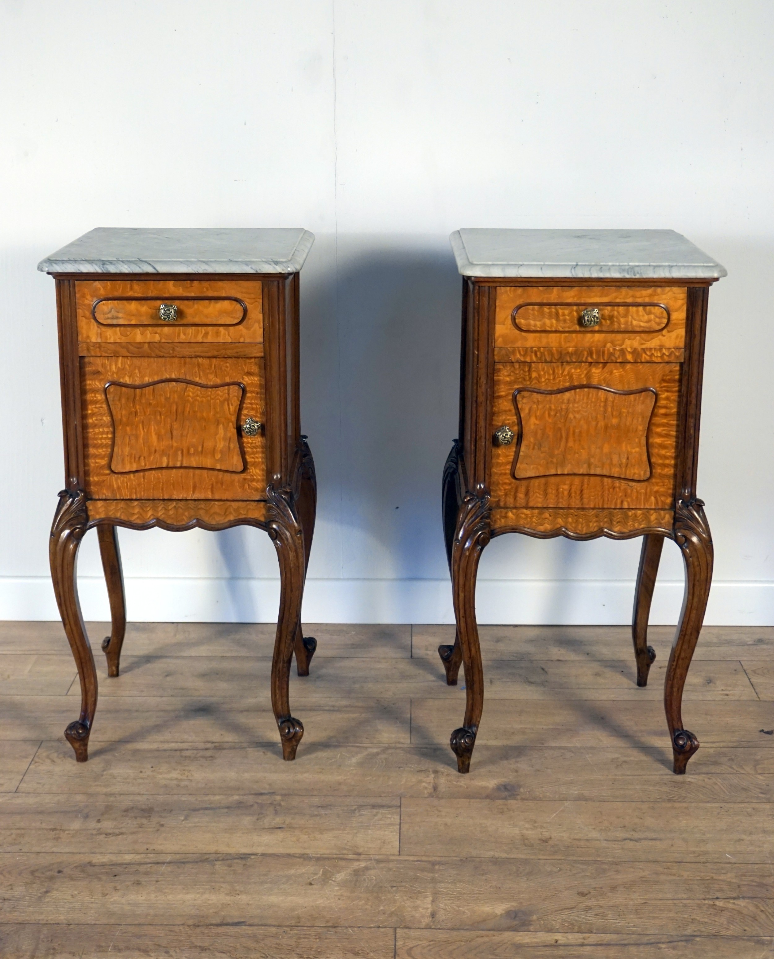 a good pair of french burr sycamore marble top bedside cabinets