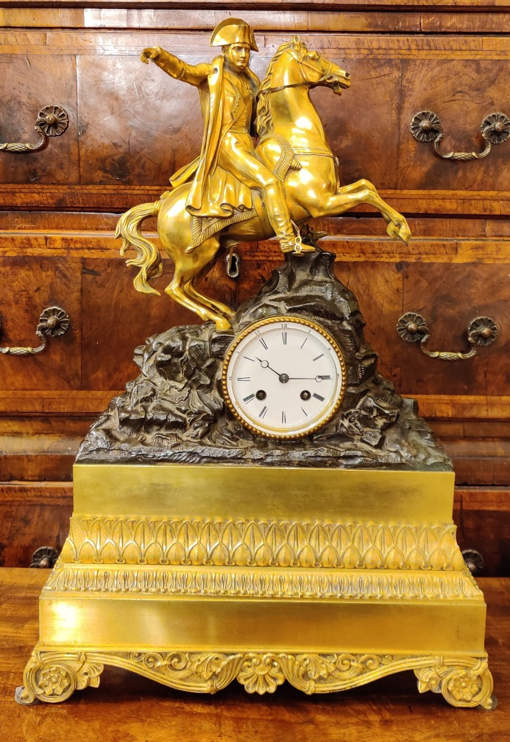 a large french gilt bronze clock depicting napoleon bonaparte by the renowned clockmaker vincenti cie napoleon crossing the alps