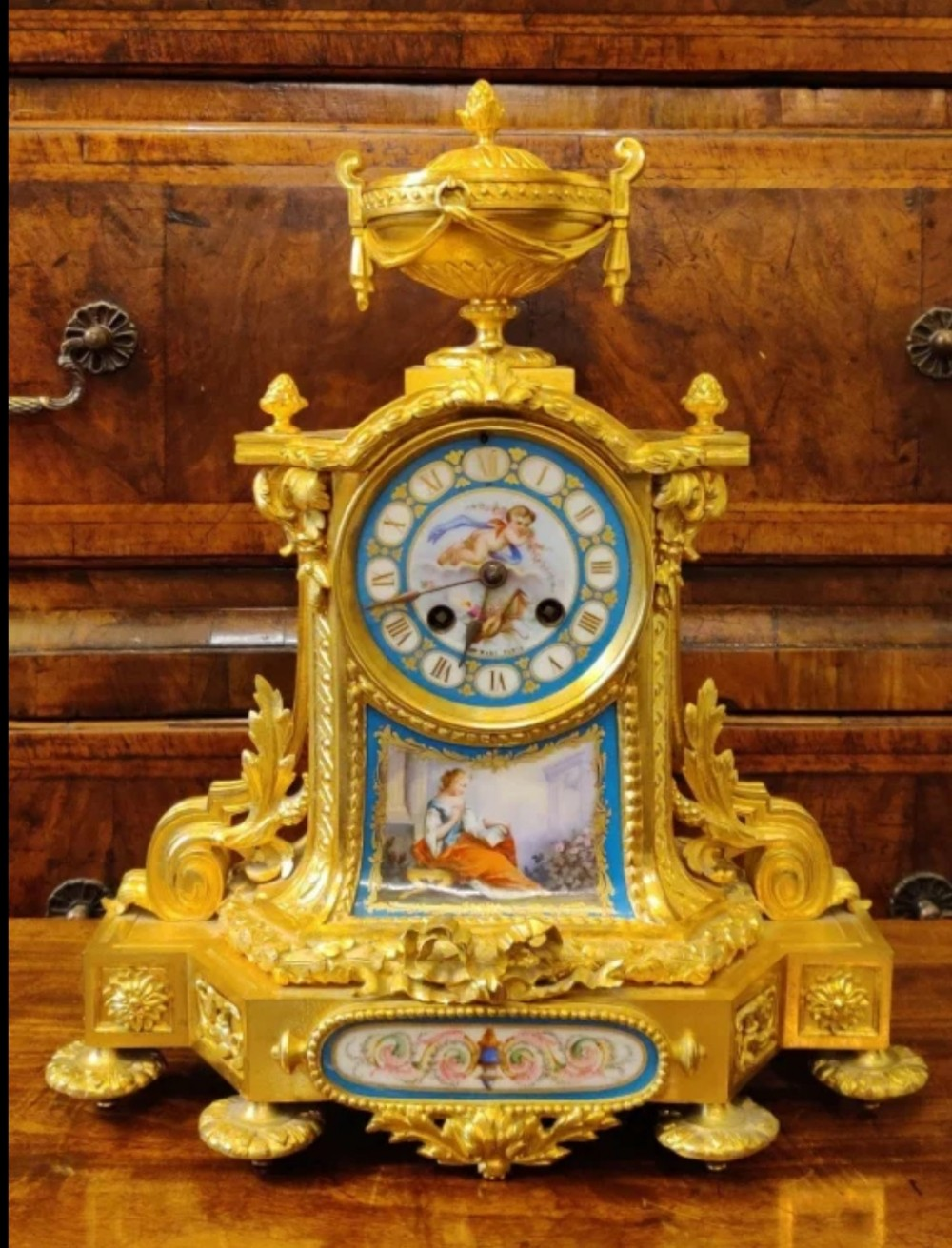 french gilt bronze ormolu clock with porcelain plaques dial
