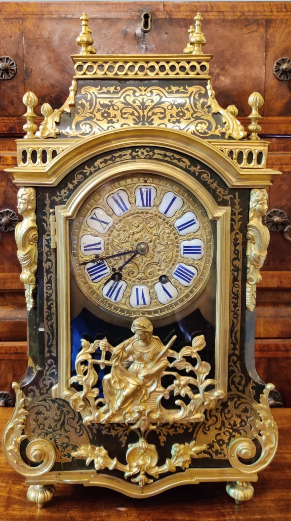 a louis xiv style boulle clock dating to the latenineteenth century