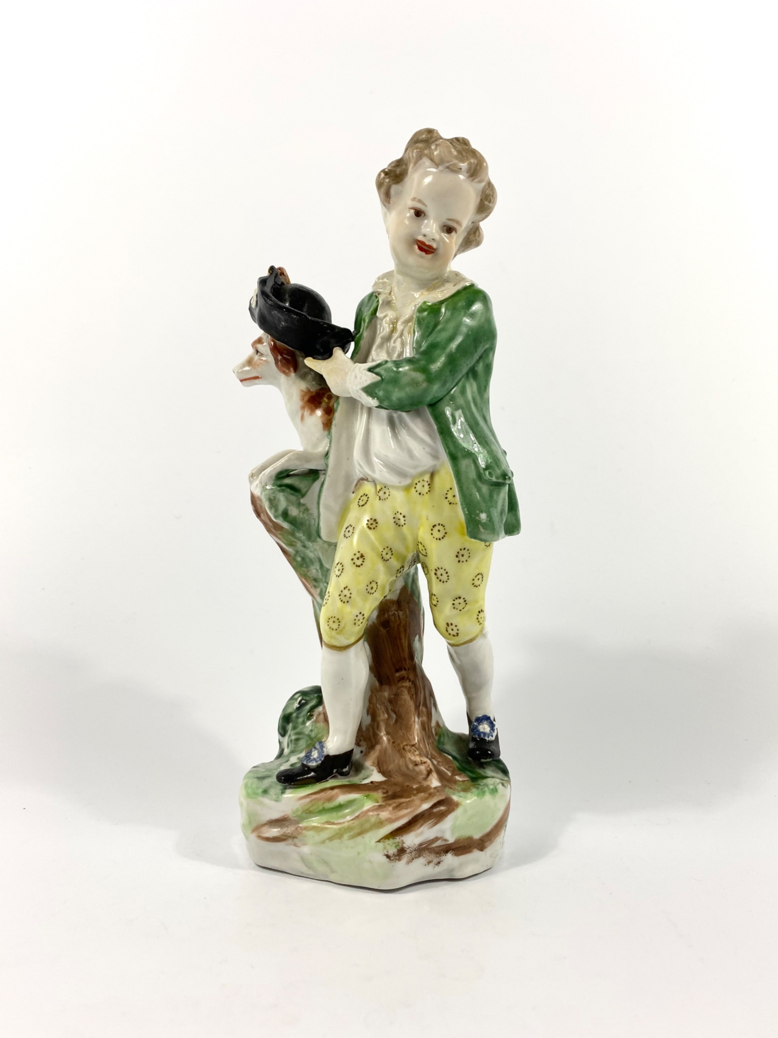 bristol porcelain figure of a boy with his dog c 1775