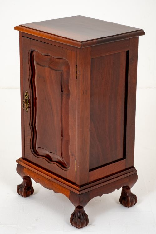 mahogany bedside cabinet with chippendale influences