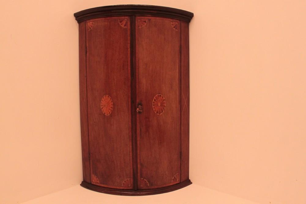 mahogany bow fronted hanging corner cupboard