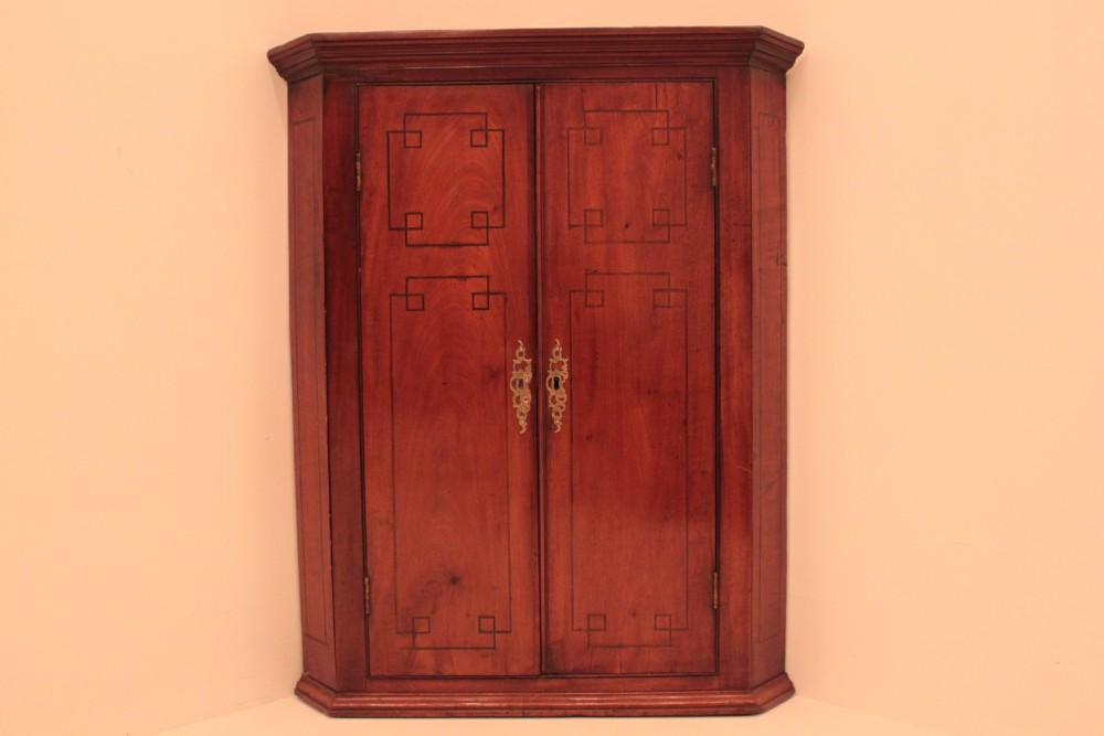 mahogany 2 door hanging corner cupboard