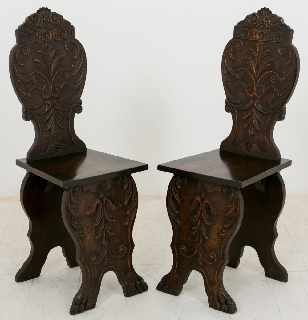 pair of lime wood carved italian hall chairs