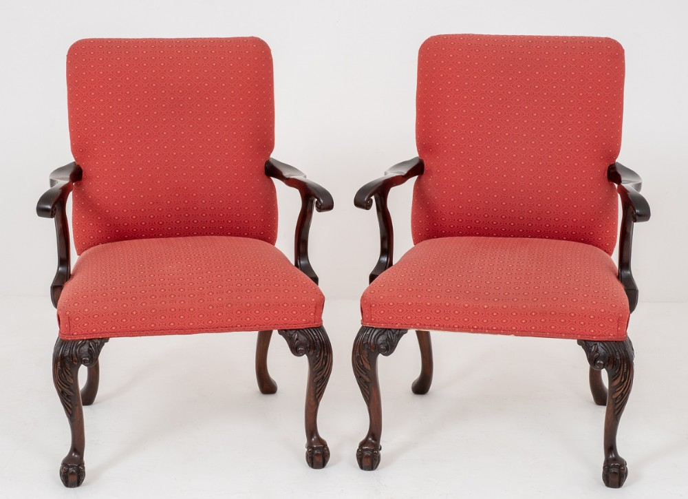 pair of mahogany chippendale style open elbow chairs