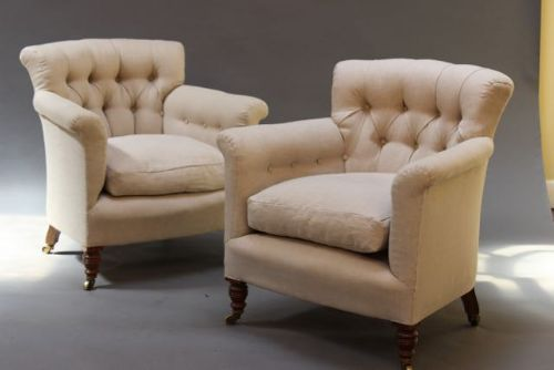 pair of 19thc howard button back armchairs