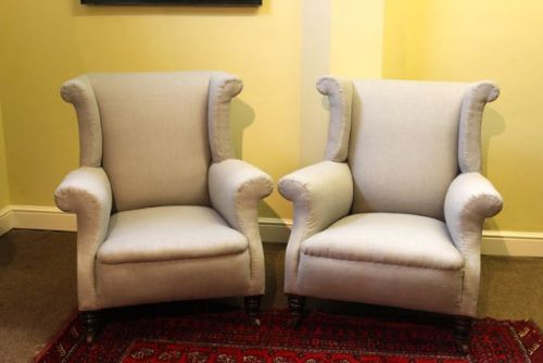a pair of 19thc wing back armchairs