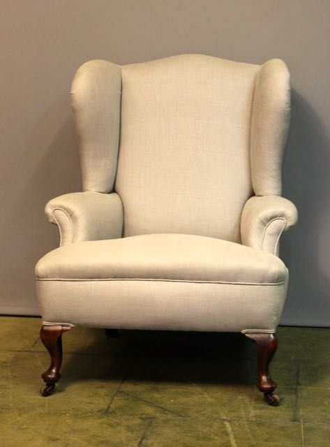 a 19thc upholstered wing armchair