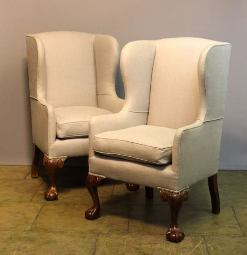 a pair of 19thc upholstered walnut wing armchairs