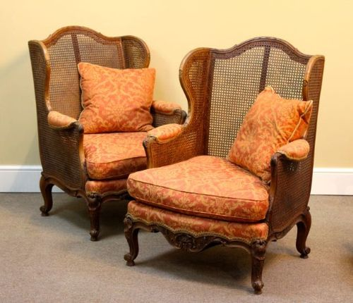 a pair of 19thc walnut wing armchairs