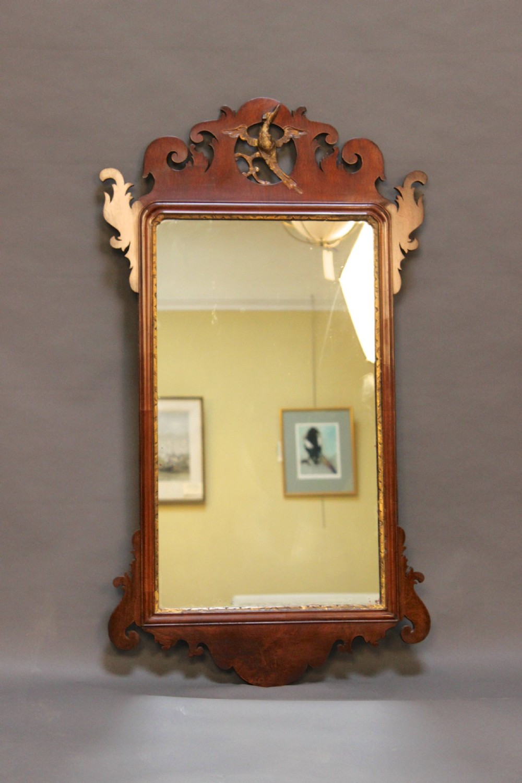 a 19thc mahogany fretted frame wall mirror