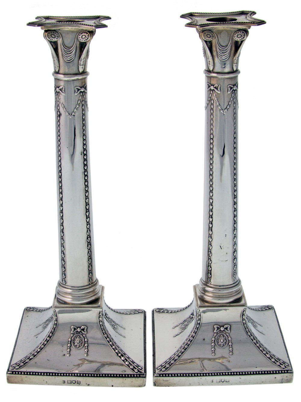a pair of edwardian silver candle sticks