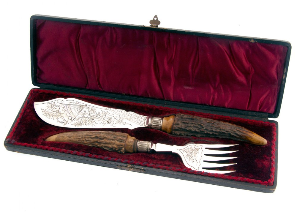 pair of boxed silver plate and stag handle fish servers